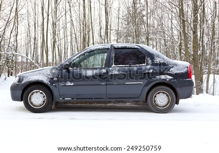 CHEREPOVETS, RUSSIA - 08 JANUARY 2015: Renault Logan parked on forest winter road. It is very popular car in Russia - stock photo