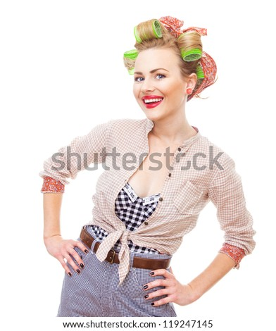 Cherfull smiling pin up retro girl with curlers. Young housewife isolated on white background