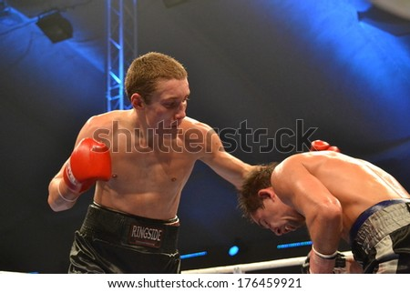 CHERKASSY, UKRAINE - DEC 15: Oleg Malinovsky (L) with dissection in the fight against Yuri Voronin (R), 15 December 2012, Budyvelnik, Cherkasy, Ukraine