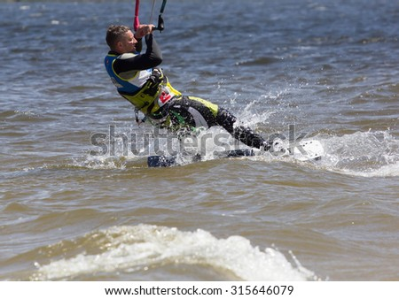 CHERKASSY, UKRAINE- JUNE 1, 2015: Athletes compete during Kite Clash Kiteboarding event in Cherkasy, Ukraine, on June 1, 2015.