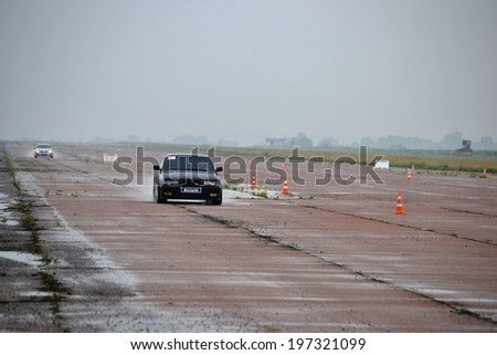 CHERKASSY, UKRAINE - JUNE 1: Unidentified drivers during 1st. stage of Ukrainian drag racing championship at the airport, on June 1, 2014 in Cherkassy, Ukraine