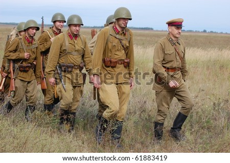 CHERNIGOW, UKRAINE - AUG 29: A members of Red Star military history club wear historical Soviet uniform during historical reenactment of WWII, August 29, 2010 in Chernigow, Ukraine