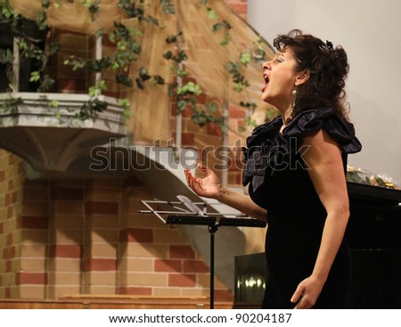 CHERNIVTSI, UKRAINE - DECEMBER 03: Elena Ursuliak, state opera singer on the concert in the Organ Hall on December 03, 2011 in Chernivci, Ukraine. - stock photo