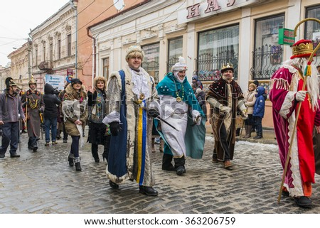 CHERNIVTSI, UKRAINE - JAN 15, 2015: Malanka Festival in Chernivtsi. Folk festivities on the streets dressed people in historical costumes. Malankain the costumes of the king and courtiers. - stock photo