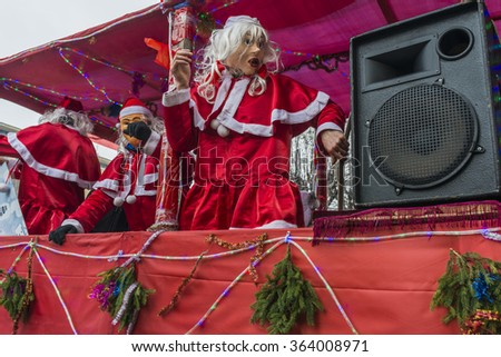 CHERNIVTSI, UKRAINE - JAN 15, 2015: Malanka Festival in Chernivtsi. Folk festivities on the streets dressed people in historical costumes. Malanka in costumes of Bishop. - stock photo