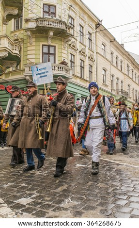 CHERNIVTSI, UKRAINE - JAN 15, 2015: Malanka Festival in Chernivtsi. Folk festivities on the streets dressed people in historical costumes. Malanka dressed as soldiers of the Austrian Empire. - stock photo