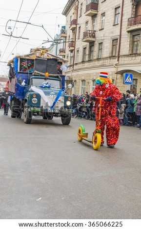 CHERNIVTSI, UKRAINE - JAN 15, 2015: Malanka Festival in Chernivtsi. Folk festivities on the streets dressed people in historical costumes. Malanka is dressed like a clown.