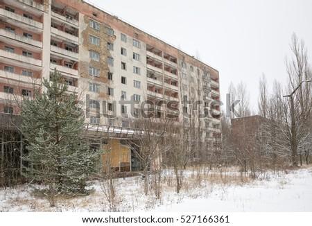 CHERNOBYL REG, UKRAINE - Nov 29, 2016: Chernobyl Exclusion Zone. Lost city. Ruins of buildings in the abandoned city of Pripyat. Winter in zone of exclusion. Zone of high radioactivity