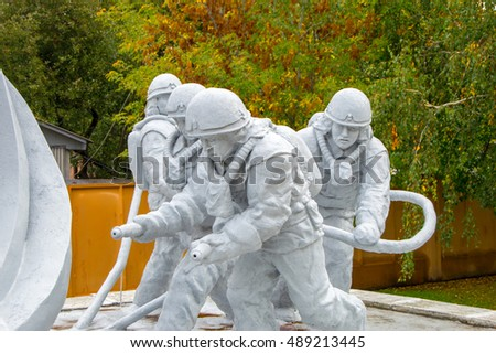 CHERNOBYL, UKRAINE - SEPTEMBER 29, 2015: Workers in the monument to the emergency workers (known as liquidators) of the Chernobyl catastrophe.