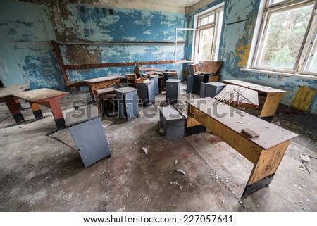 CHERNOBYL ZONE, UKRAINE - SEPTEMBER 29: classroom in Chernobyl-2 military complex (next to Duga-3 radar system) on September 29, 2014 in Chernobyl Nuclear Power Plant Zone of Alienation - stock photo