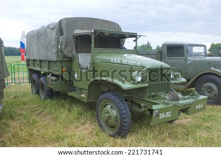 "CHERNOGOLOVKA, MOSCOW REGION, RUSSIA - JUNE 21, 2013: American military truck GMC CCKW-353, side view, 3rd international meeting ""Motors of war"" near the city Chernogolovka, Moscow region"