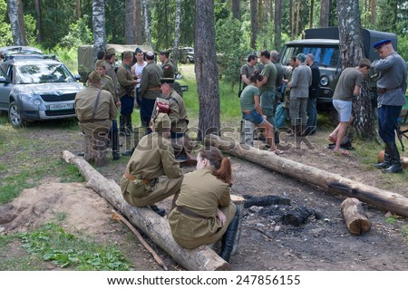 "CHERNOGOLOVKA, MOSCOW REGION, RUSSIA - JUNE 21, 2013: Rest in the forest, 3rd international meeting ""Motors of war"" near the city Chernogolovka, Moscow region"