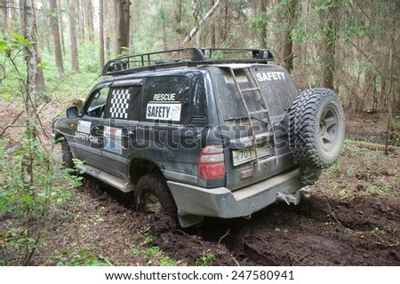 "CHERNOGOLOVKA, MOSCOW REGION, RUSSIA - JUNE 21, 2013: The car Toyota Land Cruiser stuck on a forest road,  3rd international meeting ""Motors of war"" near the town of Chernogolovka, Moscow region"
