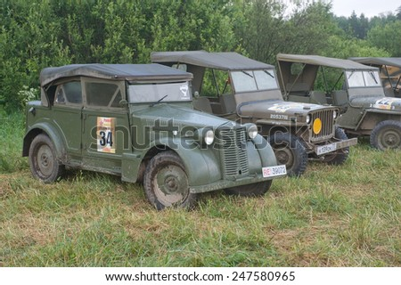 """CHERNOGOLOVKA, MOSCOW REGION, RUSSIA - JUNE 21, 2013:The number of military Italian and American vintage cars,  3rd international meeting """"Motors of war"""" near the town of Chernogolovka, Moscow region  - stock photo"""