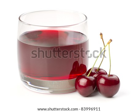 Cherries and a glass of cherry juice isolated on white background