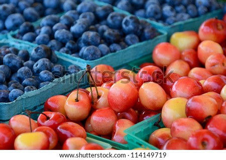 cherries and blueberries at the farmer's market - stock photo