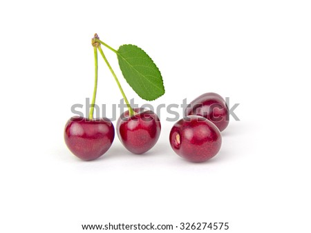 Cherries and leaf isolated on a white cutout