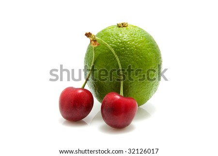 cherries and lime isolated on white background