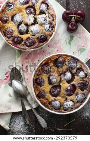 Cherries clafoutis with sugar powder - stock photo