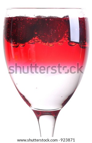 "Cherries ""dissolving"" in clear carbonated water."
