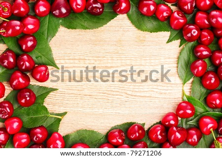 cherries frame on wooden background - stock photo