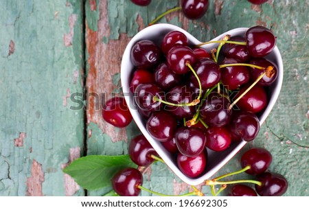 cherries in a heart-shaped bowl - stock photo