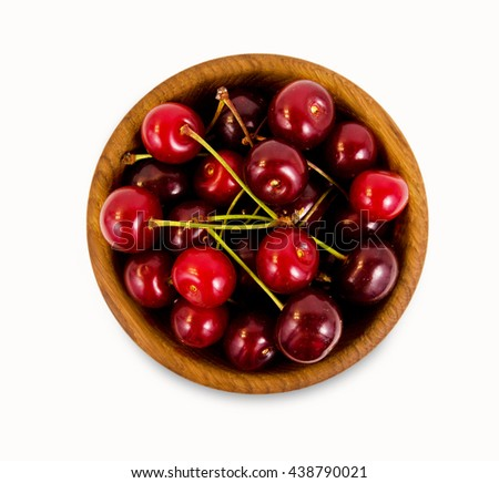 Cherries in a wooden bowl. Top view. Ripe and tasty cherries isolated on white background. Cherries in a bowl. - stock photo