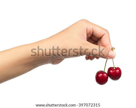 cherries in hand isolated on white background - stock photo