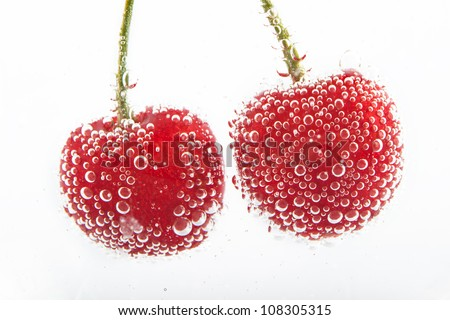 cherries in water with bubbles - stock photo