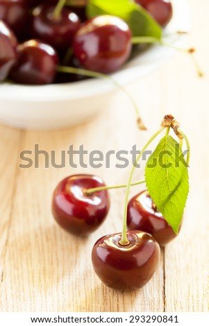 Cherries on wooden table - stock photo