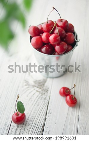 Cherries on wooden table with soft focus - stock photo