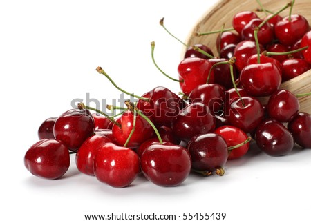 cherries spilling out from the bowl - stock photo