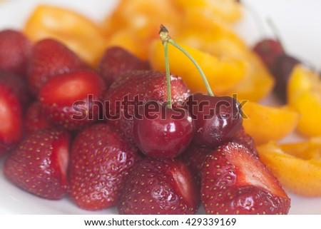 Cherries, strawberries and apricots with natural light