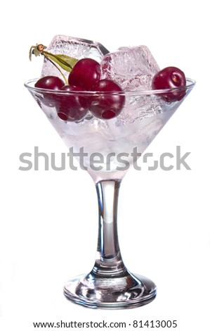 cherry and ice in  glass - stock photo