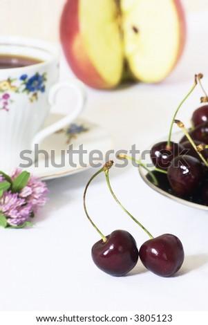 Cherry and tea - stock photo