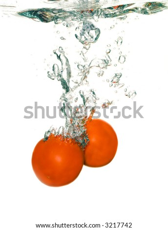 cherry are falling in water with a big splash - stock photo