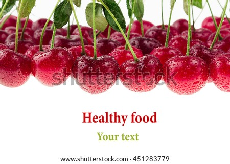 Cherry background. Bunches of ripe juicy rich shiny cherries on a white background. Isolated. Decorative fruit frame. Fresh ripe cherries with tails, leaves and water drops.  - stock photo