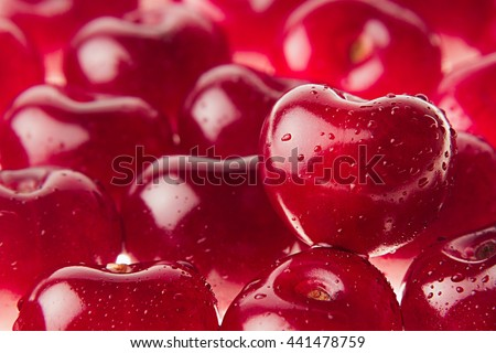 Cherry background with cherry in form of heart. Ripe fresh rich cherries with drops of water. Macro. Texture.   Fruit background. Valentine's Day. - stock photo