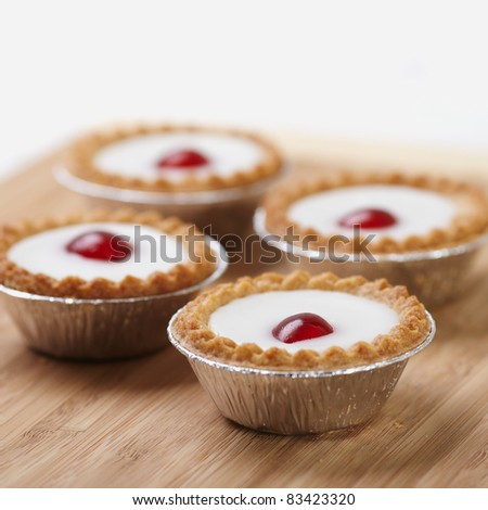 Cherry bakewell on a chopping board - stock photo
