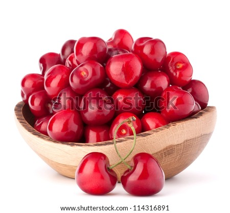 cherry berries in wooden bowl isolated on white background cutout - stock photo