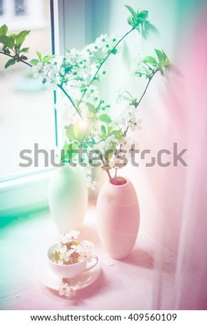 Cherry blossom in a white vase - stock photo