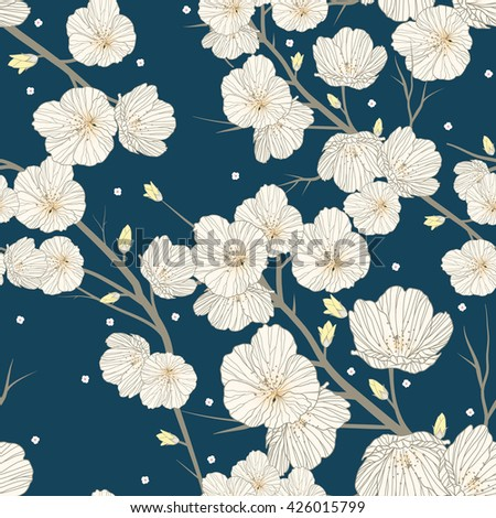 Cherry blossom seamless pattern over blue background
