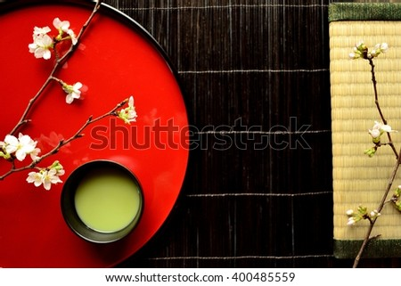 Cherry blossoms,green tea and tatami mat.Image of Japanese style interior and tea time on spring - stock photo