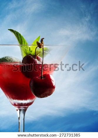 Cherry cocktail on the beach in retro style - stock photo