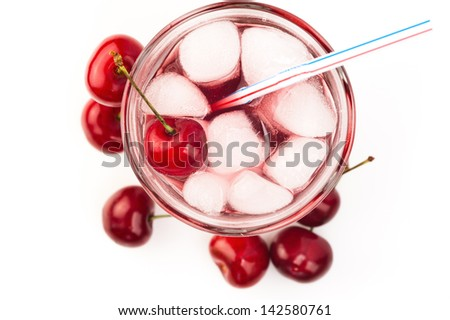 Cherry cocktail with ice on white top view