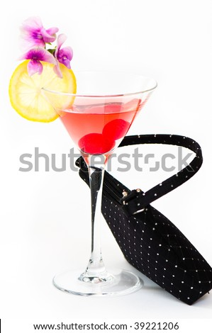 Cherry cocktail with slice of lemon - cocktail bag propped up on side of glass