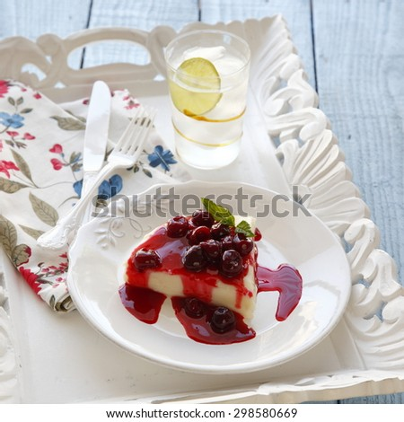 cherry dessert recipes in a vintage white tray - stock photo