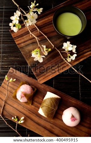 Cherry flavored Japanese sweets,green tea and cherry blossoms - stock photo