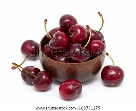 cherry in a bowl isolated on white - stock photo