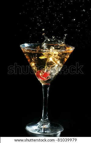 Cherry in a glass with champagne - stock photo